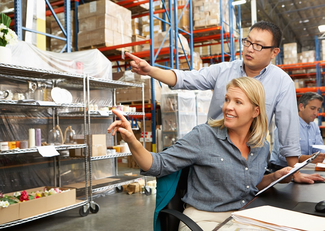CLS Blog - managers talking in warehouse